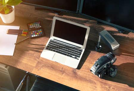 analogous: Top view of a modern desktop shot Digital Medium Format Camera with laptop on stylish Photo wooden desktop Workplace Background