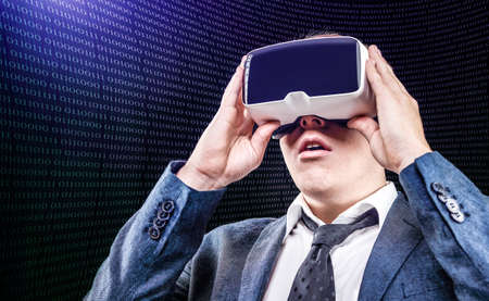 mounted: Businessman using his virtual reality VR glasses head mounted display