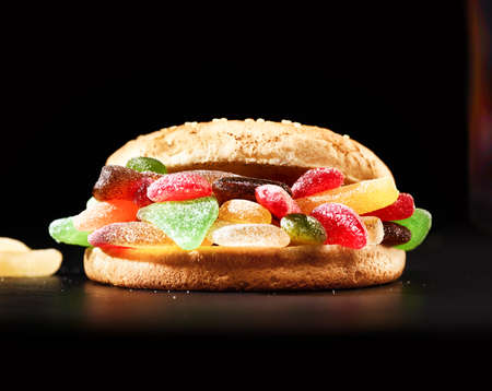 sweet tooth: Delicious homemade Hamburger made of colorful gummy sweets - the perfect snack for unhealthy teeth destruction Stock Photo