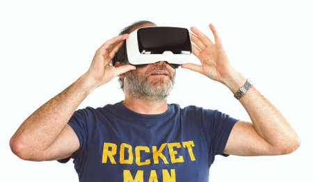 transforms: Young man wearing virtual reality VR glasses  googles. His livingroom transforms into VR space. isolated on white Stock Photo