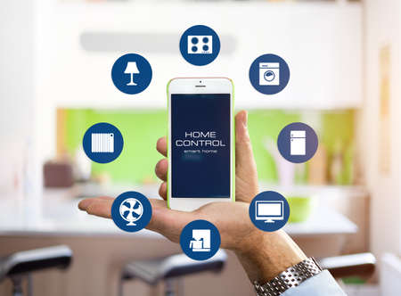 using smart phone: Using smart home app on phone. Smart home, remote control concept.