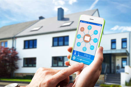 adjusting the room temperature with smart home home automation system