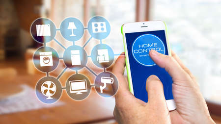 Using smart home app on phone. Smart home, remote control concept.