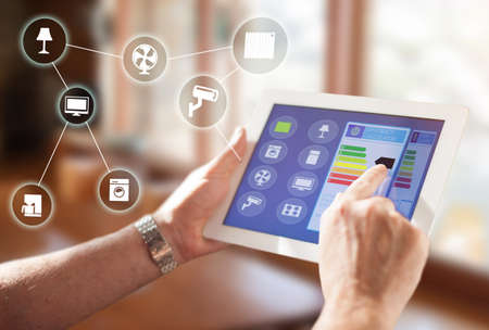 Smart Home, intelligent house automation remote control technology concept on smart phone  tablet working with smart home app