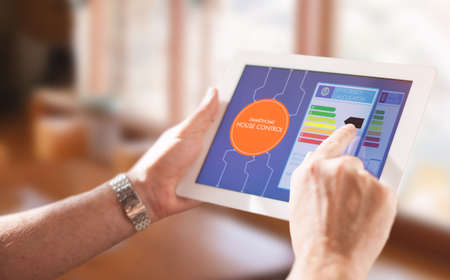 energy management: Smart Home, intelligent house automation remote control technology concept on smart phone  tablet working with smart home app