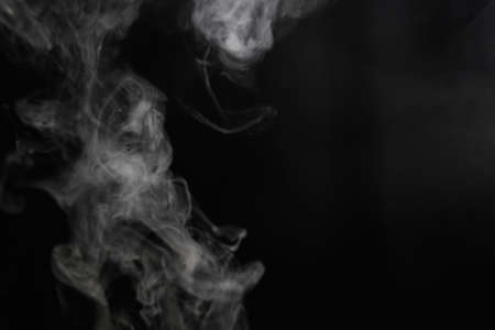 dynamic movement: Smoke on black background Stock Photo