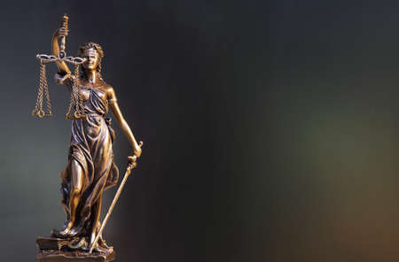 The Statue of Justice - lady justice or Iustitia  Justitia the Roman goddess of Justice Фото со стока