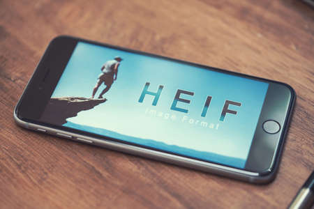 AACHEN, GERMANY - JUNE 22, 2017: HEIF Logo on  Apple iPone 7. HEIF is a new image compression used by apple in iOS 11 to reduce the storage on mobile devices, developed by the Moving Picture Experts Group (MPEG). Editöryel