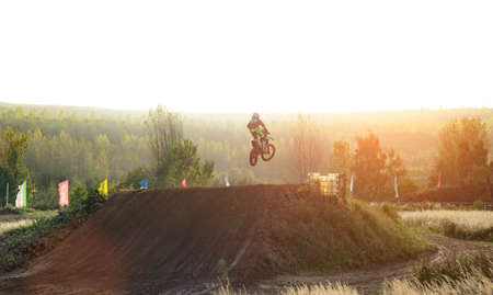 Arnoldsweiler, Germany, October 05,2017: Extreme Motocross MX Rider riding on dirt track on a sunny late summer day on public training session in preparation for motocross event. Editorial