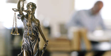 The Statue of Justice - lady justice or Iustitia  Justitia the Roman goddess of Justice in lawyer office Stock Photo
