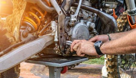 motor mechanic working on car engine in mechanics garage. Repair service. authentic close-up shot 写真素材