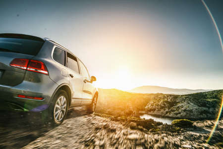 SUV car in spain mountain landscape road at sunset Imagens
