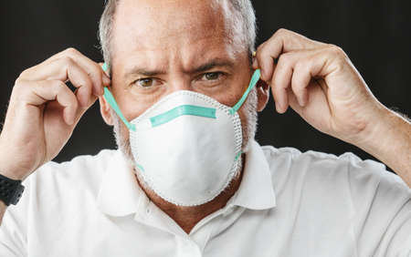 A Doctor wearing an anti virus protection mask to prevent others from corona COVID-19 and SARS cov 2 infection
