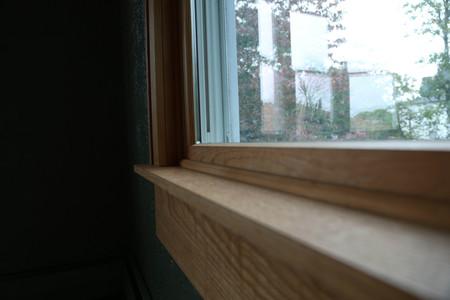 Interior windowsill view faing window.