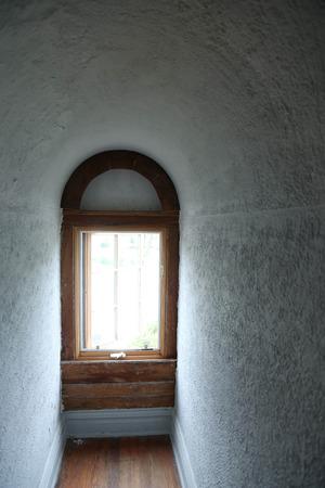 Keyhole window in an empty room