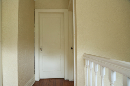 View of a bedroom door from the hallway. Zdjęcie Seryjne