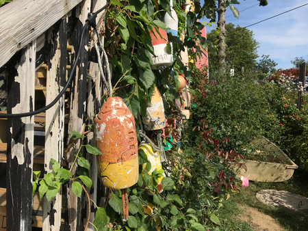 Colorful Buoys hanging from a wooden structure.