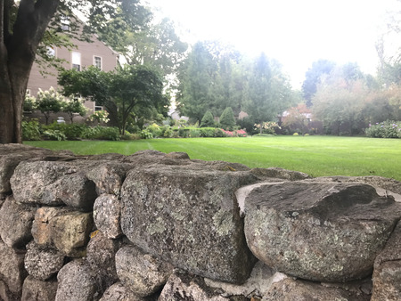 Stacked cobblestone overlooking a residential property.