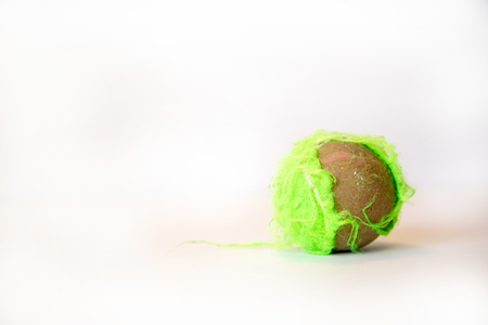 Green tennis ball chewed up by a dog. Banque d'images
