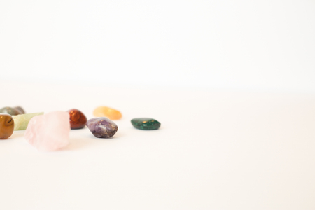 Various healing crystals on white background