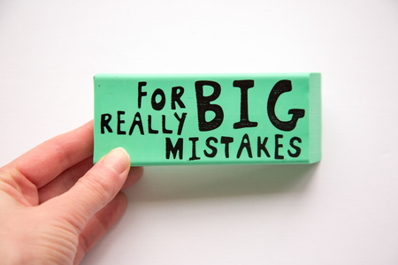 Large eraser with For Really Big Mistakes printed shot overhead on white