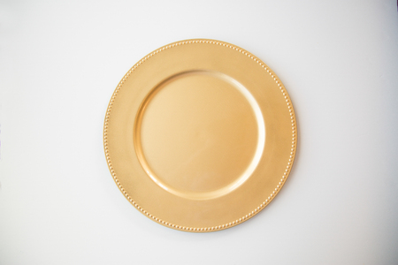 Gold plate on white background. Imagens - 97659750