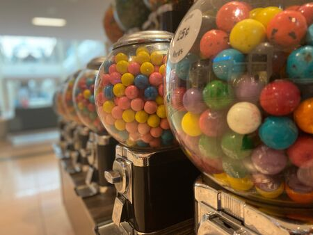 Rows of colorful candy machines in a mall