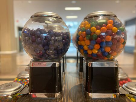 Rows of colorful candy machines in a mall Imagens - 144826910