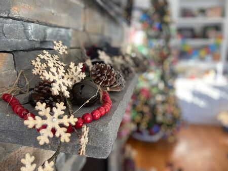 Christmas snowflakes decor on a mantle during the holiday season.