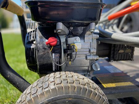 Side angle view of a power washer on a sunny day without anyone in the shot. Imagens - 147161875