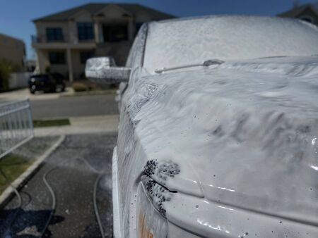 A truck with soapy suds all over it on a sunny day. Imagens - 146642792