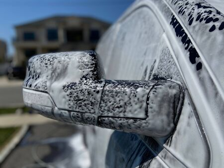 A truck with soapy suds all over it on a sunny day. Imagens - 146643279