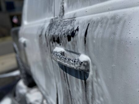 A truck with soapy suds all over it on a sunny day. Imagens - 146643205