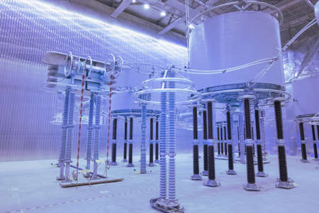 Inside high voltage direct current HVDC station. Electrical equipment in the closed substation looks futuristic