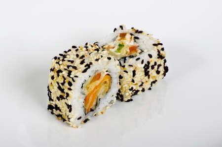 Salmon maki rolls with  sesame seeds photo