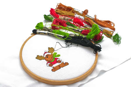 Cross-stitching process still life Stock Photo