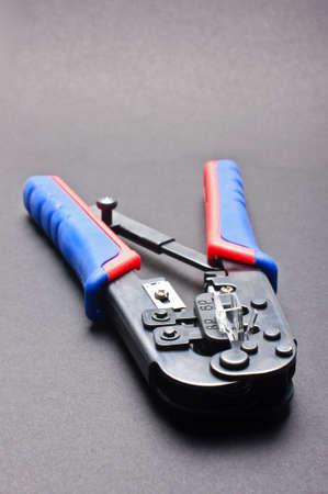 crimper: Network cable crimper on the grey background