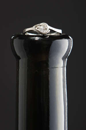 Engagement ring on the champagne bottle Stock Photo