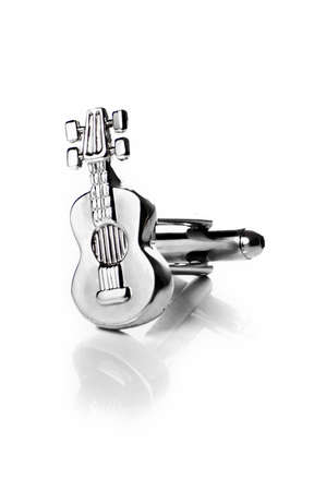 Guitar cufflink isolated photo