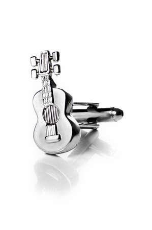 cufflink: Guitar cufflink isolated Stock Photo