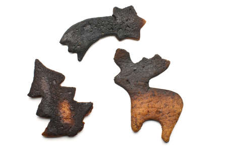 Three overcooked biscuits isolated photo