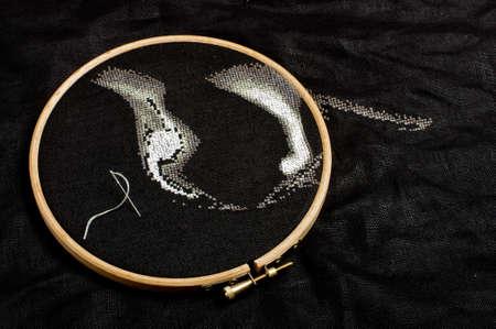 predilection: Cross stitching process on the black flax fiber