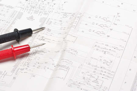 Electronic schematics and tester probes Stock Photo