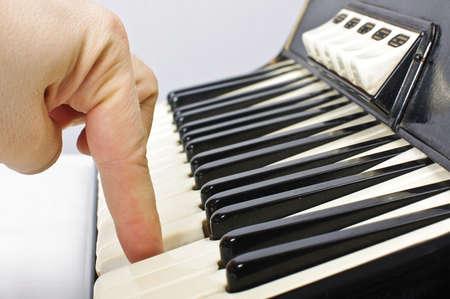 bandoneon: Playing on accordion keyboard Stock Photo