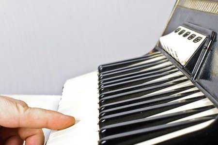 bandoneon: Finger on acordion keyboard