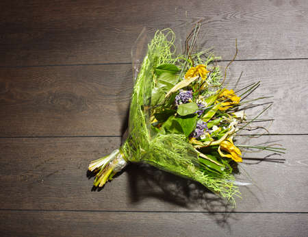 Bouquet of flowers lying on the wooden floor