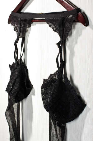 Erotick stockings hanged on the wall photo