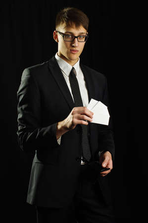 Caucasian man holding few white business cards
