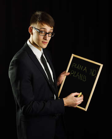 Business man holding blackboard with plan b photo