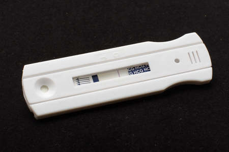 Negative pregnancy test on the black  photo